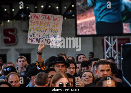 London, UK. 27th September 2018. A man holding a banner written A Star is Born attend A Star Is Born UK Premiere at Vue Cinemas, Leicester Square, London, UK 27 September 2018. Credit: Picture Capital/Alamy Live News - Stock Image