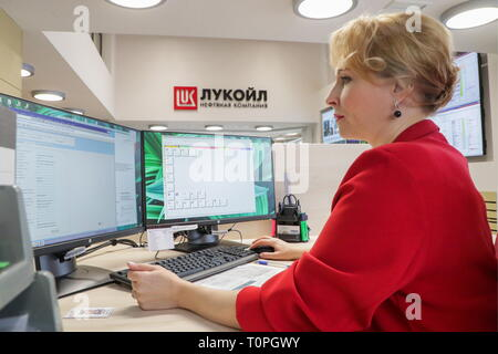 KOGALYM, RUSSIA – MARCH 21, 2019: An employee of the Lukoil-West Siberia oil and gas company. Vyacheslav Prokofyev/TASS - Stock Image