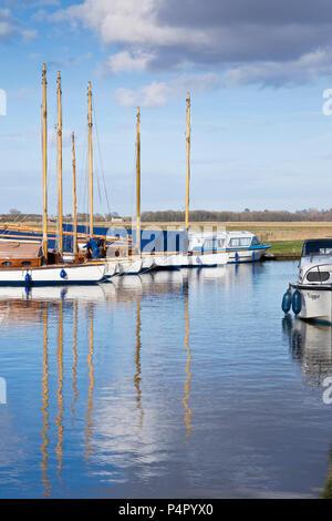 Boats moored at Upton Dyke, Norfolk UK - Stock Image