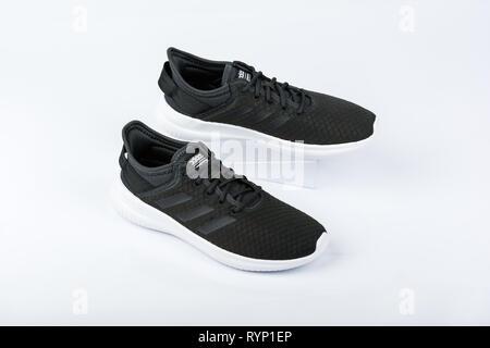 BURGAS, BULGARIA - MARCH 8, 2019: Adidas Women's Essentials Cloudfoam QT Flex Shoes Black on white background. - Stock Image