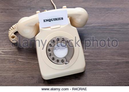 Retro telephone with note - Enquiries - Stock Image