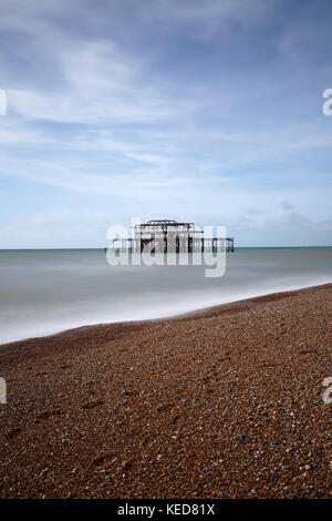 Long exposure of the derelict West pier, Brighton, East Sussex, England, UK - Stock Image