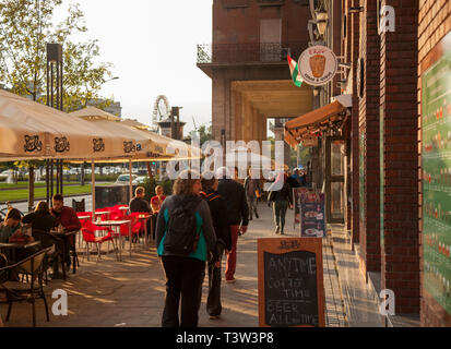BUDAPEST, HUNGARY - SEPTEMBER 20, 2017: Budapest has many restaurant patios which attract people and tourists. - Stock Image