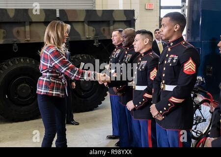 U.S. First Lady Melania Trump meets with Marine volunteers during a Toys for Tots Christmas Event at Joint Base Anacostia-Bolling December 11, 2018 in Washington, DC. Toys for Tots is a Marine Corps Program that collects new unwrapped toys and distribute those toys to less fortunate children at Christmas. - Stock Image