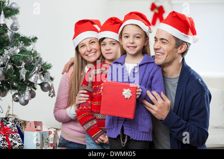 Children And Family With Christmas Gift - Stock Image