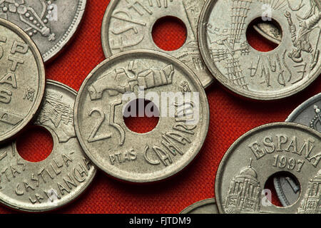 Coins of Spain. Statues by Cesar Manrique at Costa Martianez, Canary Islands depicted in the Spanish 25 peseta coin - Stock Image