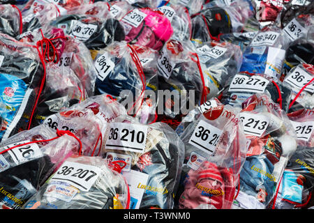 London Marathon, numbered bags after the finish line with items belonging to runners. London, England, United Kingdom, Europe - Stock Image