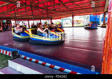 Dodgem cars, fairground ride, dodgem car, fairground rides, bumper cars, riding dodgem car, fairground fun, fairground, ride, rides, enjoying, fun, - Stock Image