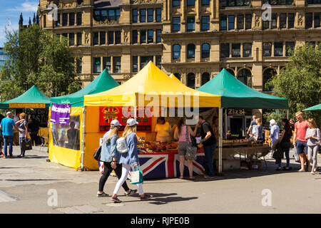 Street food market stalls in Exchange Square, Manchester, outside the old Corn Exchange. - Stock Image