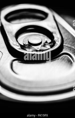 Silver aluminum soda pop can top ring pull tab - Stock Image