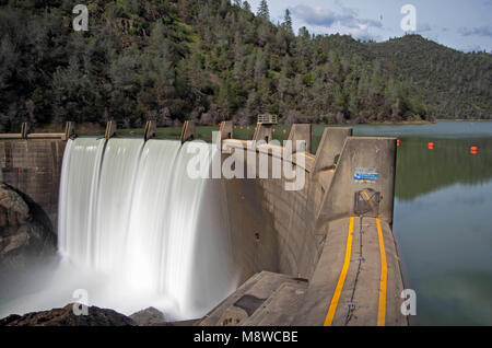 When the water level of Lake Clementine gets to a certain level, a waterfall is created by the North Fork Dam. - Stock Image