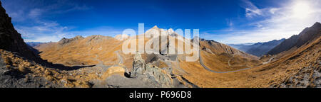 Panoramic view on Col Agnel in Hautes-Alpes in Fall. In the center, the mountain peak Pain de Sucre. Queyras Regional National Park, France - Stock Image
