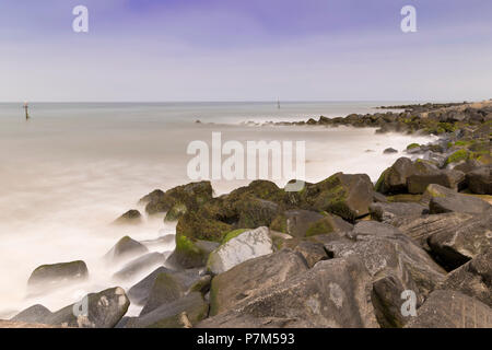 Long exposure image of the sea defences on a summers day at Sheringham beach, Norfolk, UK. - Stock Image