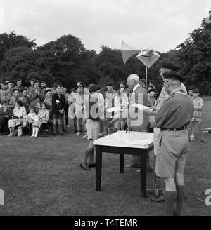 1960s. historical, a young male scout receiving his certiicate - Stock Image