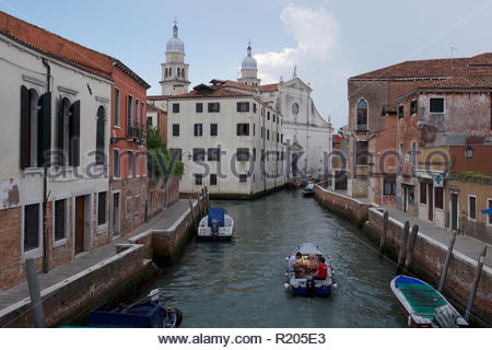 Small boats and buildings in  the university district of Dorsoduro: Venice. - Stock Image