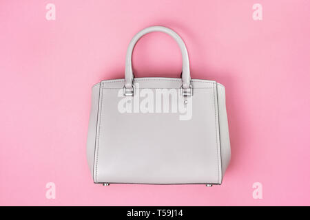 gray female bag on a pink background. view from above. copy space - Stock Image