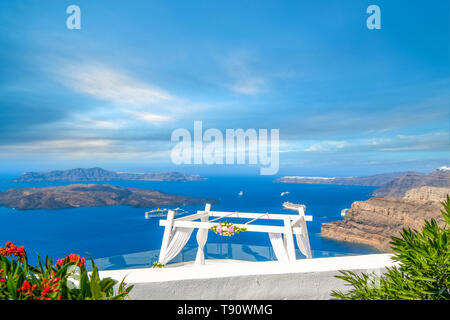 View of the Aegean Sea, cruise ships, and the Santorini Caldera from a mountaintop wedding venue in Santorini Greece. - Stock Image