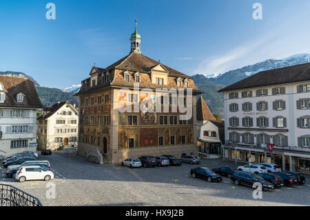Town hall of Schwyz, capital of the Swiss canton of Schwyz, featuring an elaborate mural of the battle of Morgarten - Stock Image