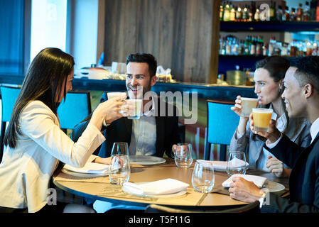 Business people drinking beer in bar - Stock Image