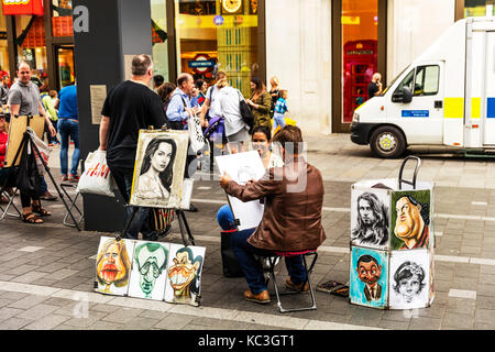 London street artist, street artist London UK, street artist portraits, street artist sketching, street artist sketches,drawing - Stock Image