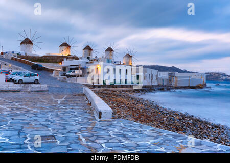 Traditional windmills at sunrise in Mykonos, Greece - Stock Image