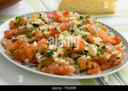 Traditional  Moroccan  fresh vegetable salad closeup and bread - Stock Image