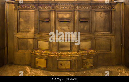 Mexico City main post office was built in 1907 and is comprised of many architectural styles including extensive use of ornate polished brass. - Stock Image