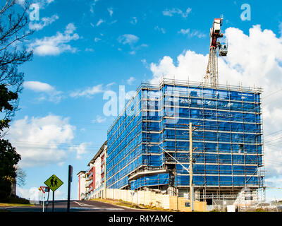 Blue sky Perspective view on developing new home units building site at 47 Beane St.Gosford, New South Wales, Australia. Construction site progress. - Stock Image
