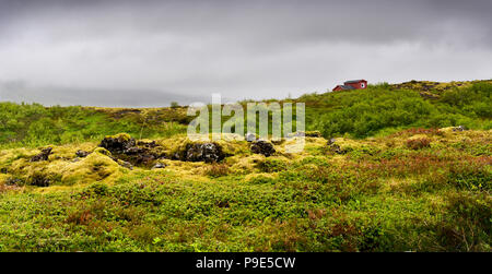 a small red hut in an icelandic landscape - Stock Image