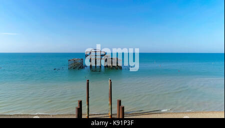 View of the destroyed West Pier in Brighton on a summer morning - Stock Image