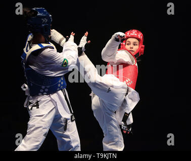 Brazil's Caroline Santos (blue) competes against Croatia's Bruna Vuletic in the Semi Final of the WomenÕs -62kg during Day 5 of the World Taekwondo Championships at Manchester Arena. - Stock Image