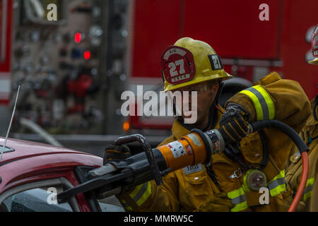 Los Angeles, California, USA 12 May 2018 A Los Angeles City Firefighter using a rescue tool. - Stock Image