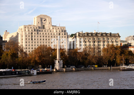 Victoria Embankment London Shell Mex building on left - Stock Image