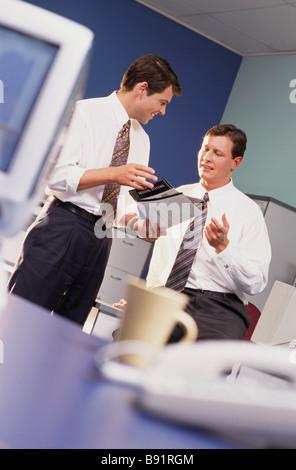 Businessmen having office meeting - Stock Image