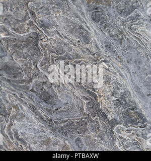 Weathered by the sea, close-up of coastal rock surface at Newquay. - Stock Image
