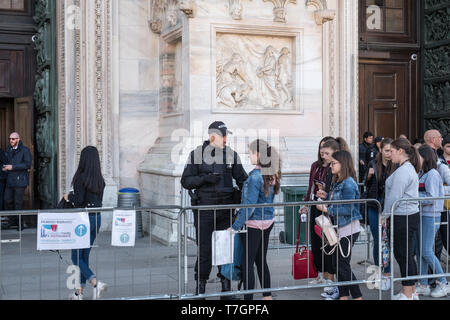 Milan Cathedral (Duomo), Italy. Security staff carry out checks on tourists queuing to go inside the cathedral. - Stock Image