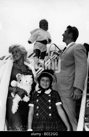 Actress Jayne Mansfield, her husband actor and bodybuilder Mickey Hargitay, with their children at an airport. - Stock Image
