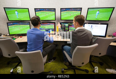 VAR referee Bas Nijhuis (left) and his operator Mike van der Roest (right) working at the VAR center in the headquarters of the Dutch football associa - Stock Image