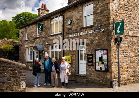 UK, Cumbria, Sedbergh, Main Street, senior visitors on coach trip at Dales & Lakes Book Centre and Tourist Information Centre - Stock Image