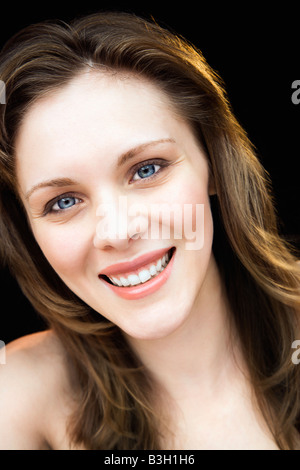 Close up portrait of young adult caucasian female smiling - Stock Image