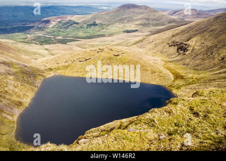 Panorama of Lough Curra nestled at the foot of Galtymore Mountain.County Tipperary,Ireland. - Stock Image