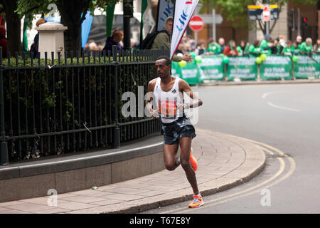 Elite Male Athlete, Tamirat Tola competing for Eithiopia, in the 2019 London Marathon. He went onto finish in 6th place, in a time of 02:06:57 - Stock Image