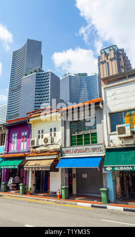 DUO and Parkview office towers over Arab Street traditional shophouses fabric shops Kampong Glam Singapore. - Stock Image