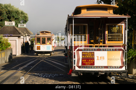The Number 18 Hyde and Beach Trolley waits while another car is loaded getting ready to head up the hill on an early - Stock Image