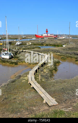Essex coast landscape & coastal countryside from Tollesbury Wick with River Blackwater salt marshes mud yacht mooring area & moored red lightship UK - Stock Image