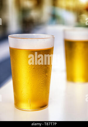 Two misted plastic beer cups outdoor - Stock Image