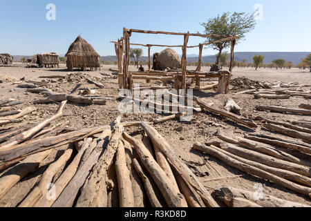 Africa, Namibia, Opuwo. Construction logs in front of framed building. Credit as: Wendy Kaveney / Jaynes Gallery / DanitaDelimont.com - Stock Image