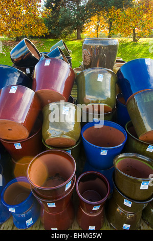 image of ceramic flower pots stacked at garden centre - Stock Image