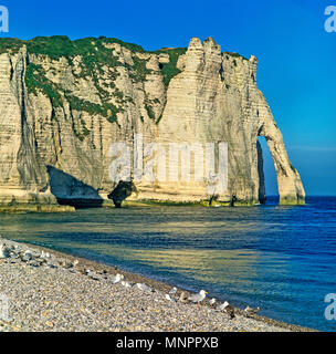 THE ICONIC ARCH PORTE D'AVAL. ETRETAT. NORMANDY. FRANCE. JUNE 2014. The iconic cliffs and the Arch Porte d'aval at the town of Etreat in Normandy made - Stock Image