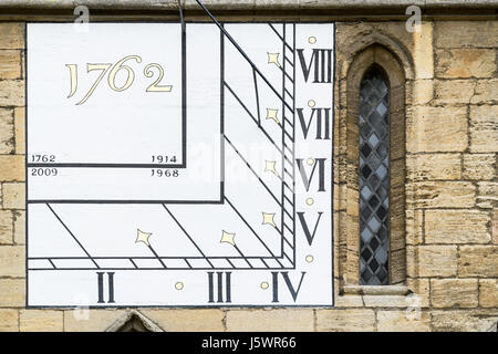 Eighteenth century sundial on the western wall of the medieval christian cathedral at Northampton, England. - Stock Image